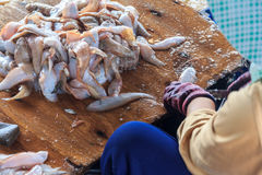 Fisherwoman Cutting Up And Cleaning The Fish Royalty Free Stock Images