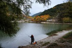 The fisherwoman by the lake near the Crimean Mangup-Kale mountain. In the central part of the mountain Crimea royalty free stock images
