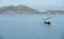 Fisherwoman with net at loktak lake Stock Image