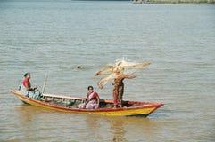 Fisherwomen & swimmers Royalty Free Stock Photography