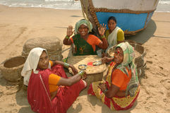 Fisherwomen women on the beach in the shade of the boat Stock Images