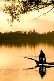 Fishery. Fisherman seat on the ponton at evening Royalty Free Stock Photos