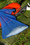 Fishery. Into a net blue bag with spear fishing diving gear Stock Photography