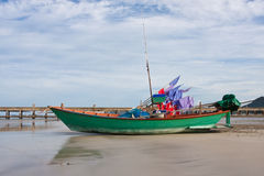 Fishery boat. Green fishery boat stay on beach, Thai sea image Royalty Free Stock Photo