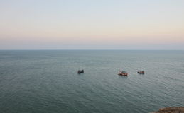 Fishery boat floating on the sea Stock Photos