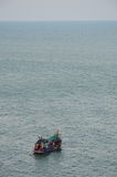 Fishery boat floating on the sea Stock Photography