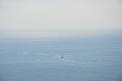 Fishery boat floating on the vast sea Stock Image