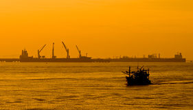 Fishery boat over sea port in Thailand Royalty Free Stock Images