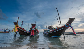 Fishery boats anchor at Gulf of Thailand beach Stock Images