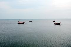 Fishery boats floating on the sea Royalty Free Stock Image
