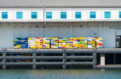 Fishery dock with colorful crates stock photography