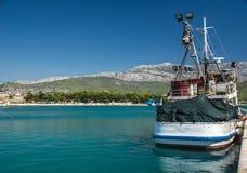 Fishery ship in a bay. Stobrec, Croatia. Royalty Free Stock Photos