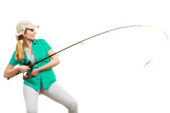 Woman with fishing rod, spinning equipment. Fishery, spinning equipment, angling sport and activity concept. Happy smiling woman with fishing rod stock photos