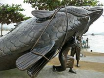 Fishery statue in the park stock photo