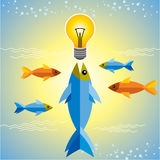 Fishes around the bulb. Gold and blue fishes around the bulb Stock Photos