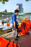 Fishes are kept in plastic bags preparing to be released in the Saigon river in the National Fisheries day in Vietnam Stock Image