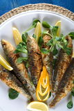 Fishes with lemon Stock Photos