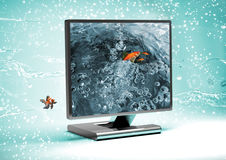 Fishes in the monitor Royalty Free Stock Image