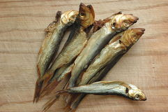 Fishes of sprat on a wooden surface Royalty Free Stock Photography