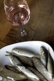 Fishes and wine Royalty Free Stock Photo