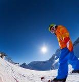 Fisheye观点的滑雪帽滑雪的微笑的男孩 免版税库存照片