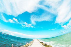 Fisheye Beach Pier with Sky Stock Photo