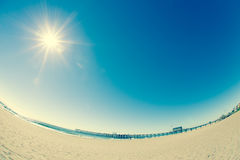 Fisheye Beach. Fisheye view of sandy beach and sun stock image