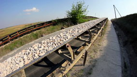 Fisheye of a conveyor belt transporting stones stock video