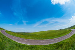 Fisheye de la curva del camino Fotografía de archivo