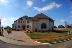 Fisheye dream home. A modern dream home shot in fisheye against bright blue sky Royalty Free Stock Images