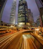 Fisheye Hong Kong. Night Fisheye view of IFC (International Financial Centre) in Hong Kong with curving traffic light track Stock Photo