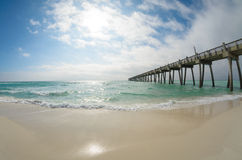 Fisheye landscape of Pensacola Beach's fishing pier. At Pensacola Beach, Florida on the Gulf of Mexico. Emerald Coast. Upside of Florida. Sand, sky, sun, water royalty free stock photo