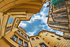 Fisheye lens look of the Old Town on sky background . Prague Stock Images