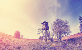 Fisheye lens photo of a hunting pulpit at sunset. Royalty Free Stock Photos