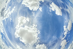 Fisheye lens picture of clouds on blue sky Stock Photo