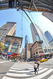 Fisheye lens picture of pedestrian crossing at busy Fifth Ave and East 33rd St corner. Stock Photography