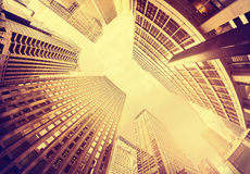 Fisheye lens vintage toned photo of skyscrapers in Manhattan at Royalty Free Stock Image