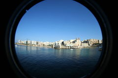 Fisheye panorama of Sliema, Malta. View of limestone beach mediterranean sea coastline and paceville st. julians hotels condominiums development from sliema Stock Images