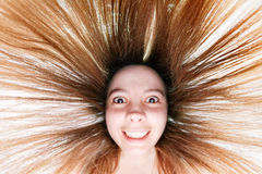 Fisheye portrait. Pretty woman with dishevelled hair shot with fisheye royalty free stock photos