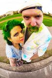 Fisheye portrait of man and women during holi festival Stock Images