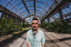 Fisheye portrait of short hair girl in an abandoned factory Royalty Free Stock Photos