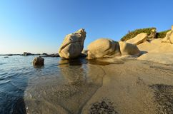 Fisheye seascape 3. Seascape fisheye view with a huge stones in golden evening sunlight, Carydi beach, Chalkidiki, Sithonia, Greece Stock Photography