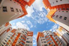 Fisheye shot of new resitential buildings. Fisheye shot of new apartments buildings exterior stock image
