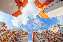 Fisheye shot of new resitential buildings. Fisheye shot of new apartments buildings exterior Royalty Free Stock Photos
