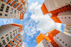 Fisheye shot of new resitential buildings. Fisheye shot of new apartments buildings exterior Royalty Free Stock Image