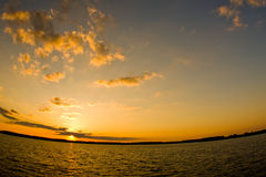 Fisheye sunset. A scenic sunset over water with fisheye lens distortion Stock Images