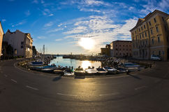 Fisheye view of boats, blue sky and sun reflection at Piran harbor, Istria Stock Image