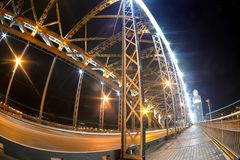 Fisheye view on Bolsheokhtinsky bridge across Neva River in St. Petersburg in night illumination Stock Photography