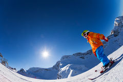Fisheye view of boy on beautiful mountain slope. Fisheye view of boy on slope of beautiful mountain skiing during sunny winter day on Krasnaya polyana, Sochi stock photos