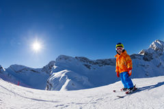 Fisheye view of boy skiing on mountain slope Royalty Free Stock Photography